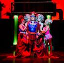 The courteseans surround Miles Gloriosus in Act I of Forum.