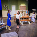 Susan speaks to Jennifer amidst their fight in Act II.