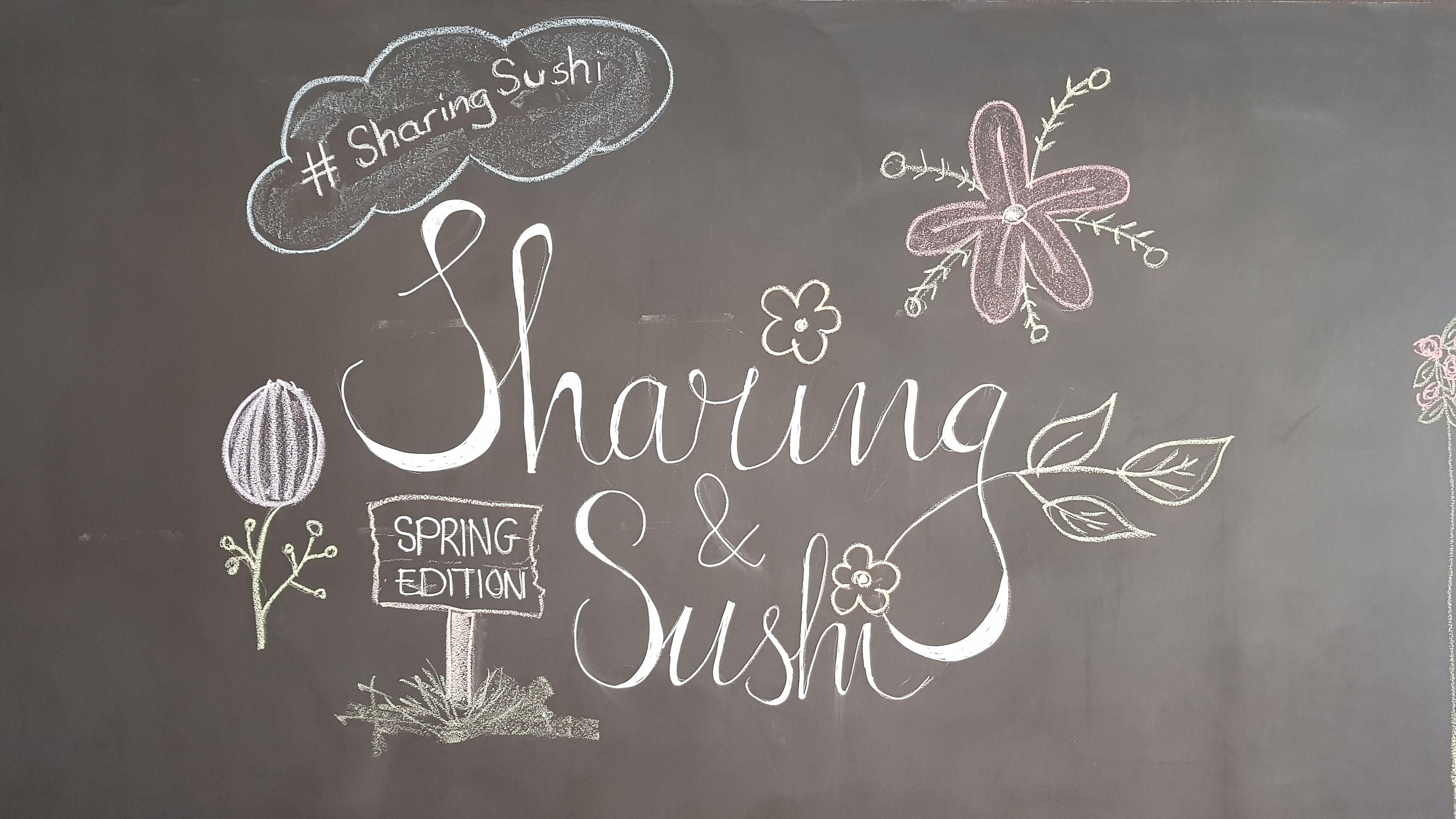 Krijtbord met Sharing en Sushi tekst
