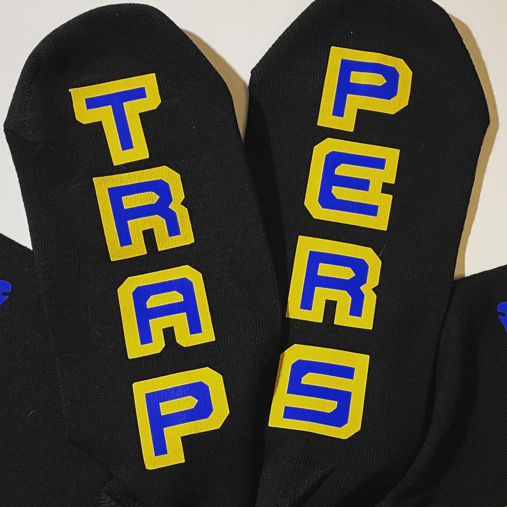 Zwarte sokken met de tekst Trappers