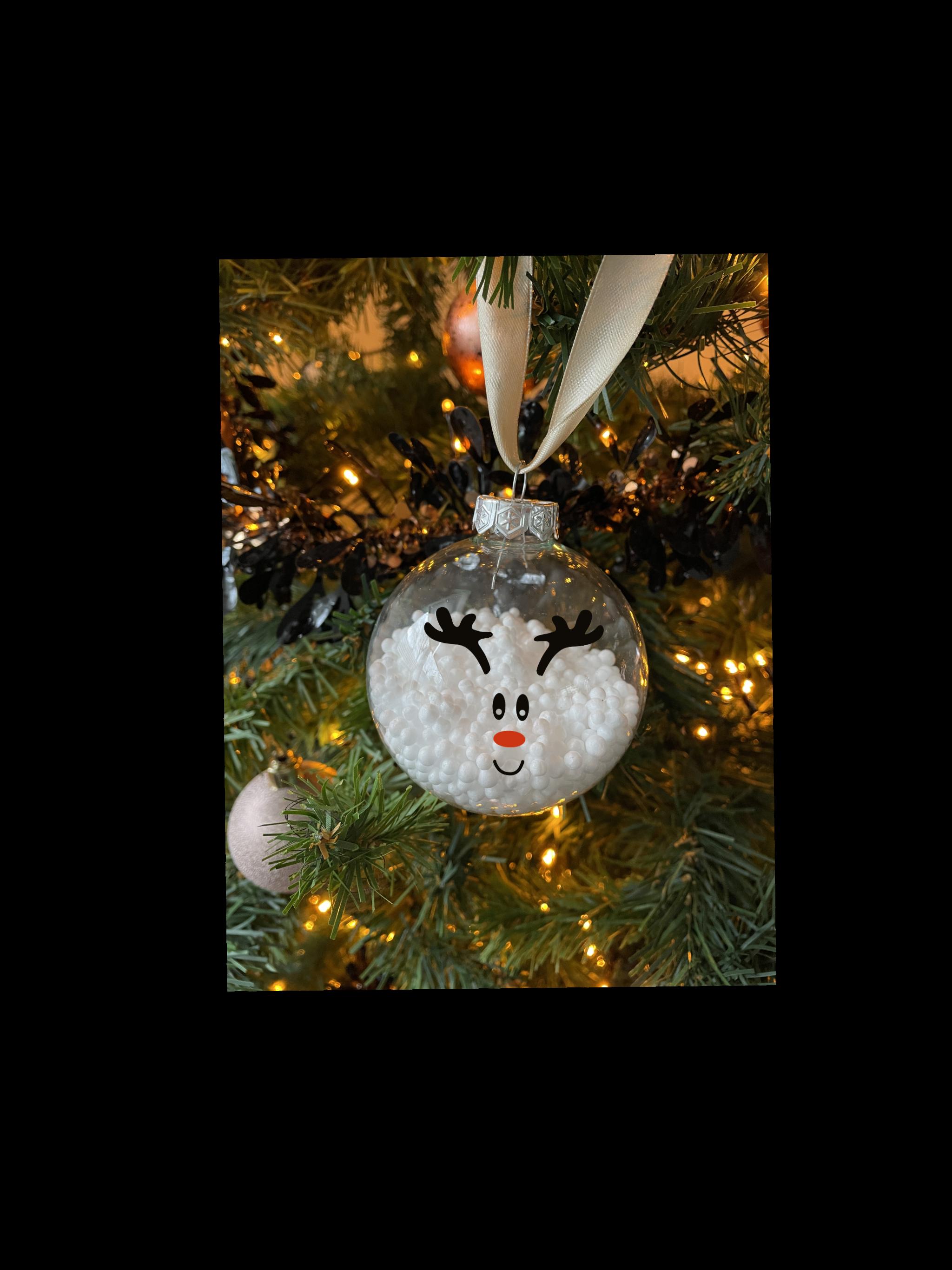 Glazen kerstbal met sneeuw en rendier