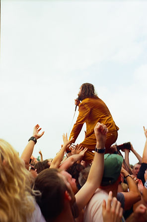 orange suit, crowd surfing