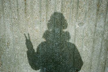 Peace sign, shadow