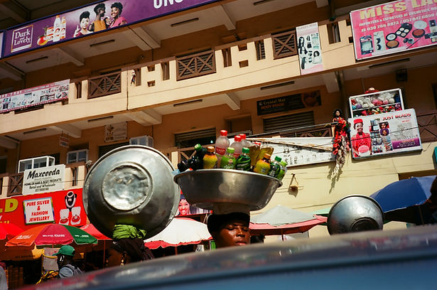 Kantamanto market, basket, head, market, seller, drinks, struggle, balcony, balconies, Accra, Ghana