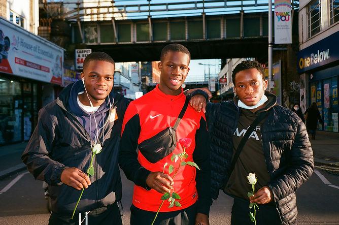Teni, Victor and Leo, three boys, flowers, rye lane