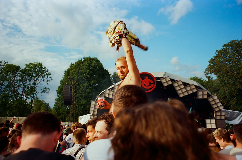 guy on shoulders, man, shirt in the air
