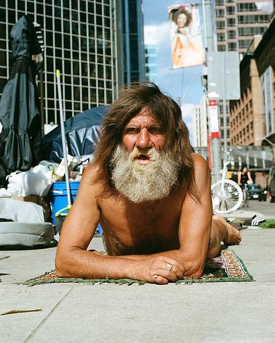 Homeless man, city hall, beard, portrait of humanity, topless, rug, sunny, outside