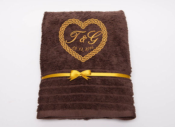 Embroidered towel with celtic knot heart frame