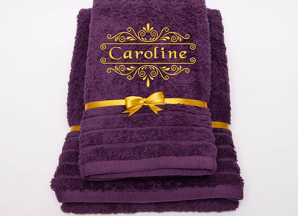 Embroidered towel with name in gold frame