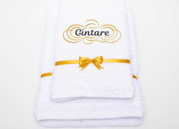 Embroidered towel with name in gold cloud frame
