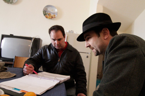 Producer Kenneth Del Vecchio and Dylan Bank review the screenplay in Ciro, Italy