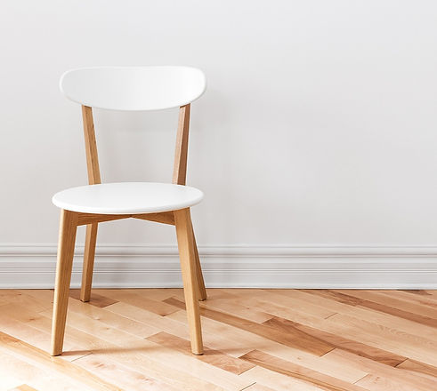 White%20Chair%20in%20an%20Empty%20Room_e