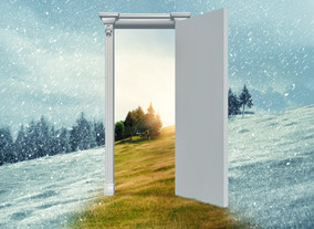 Opened door on a field during winter whi