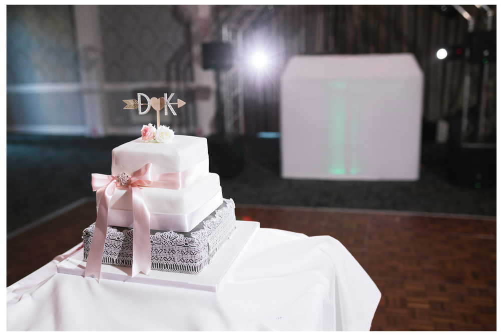 wedding photographer edinburgh fun happy bride groom wedding cake