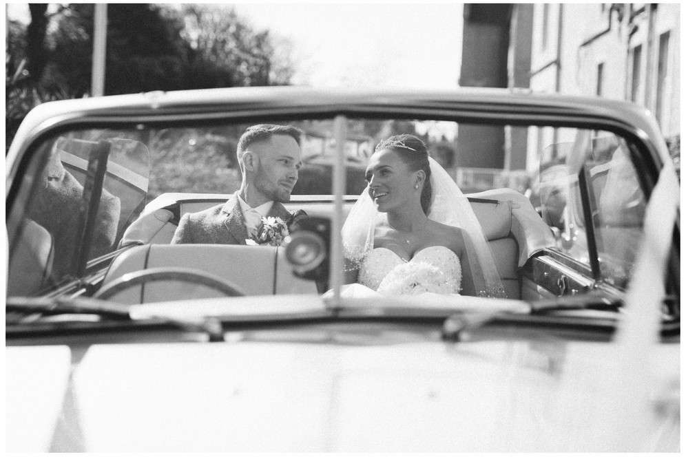 wedding photographer edinburgh fun happy black and white vintage car
