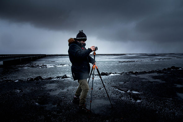 Photographer-with-Camera-on-Tripod-at-sea-on-stormy-weather.jpg