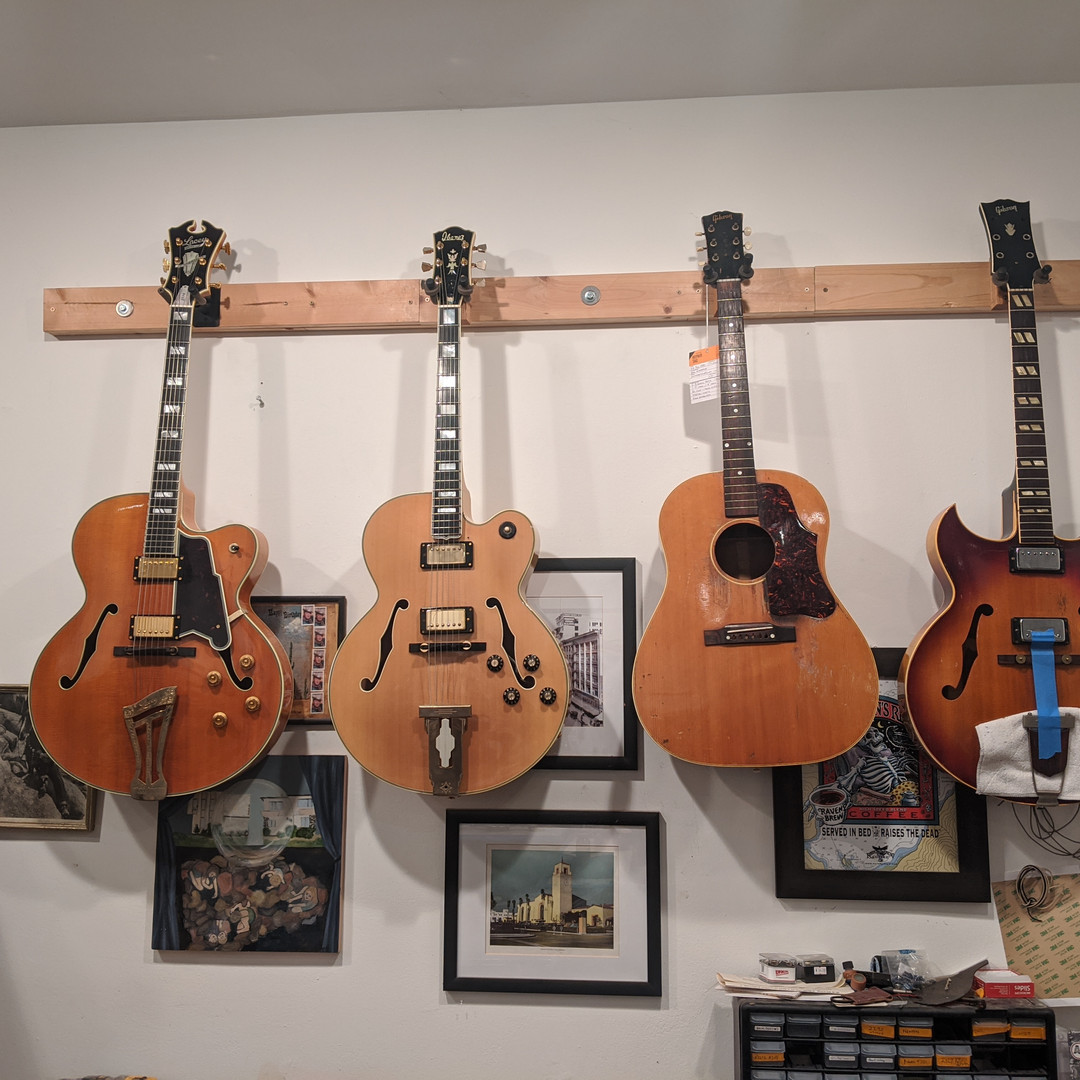 Guitars in Line for Work