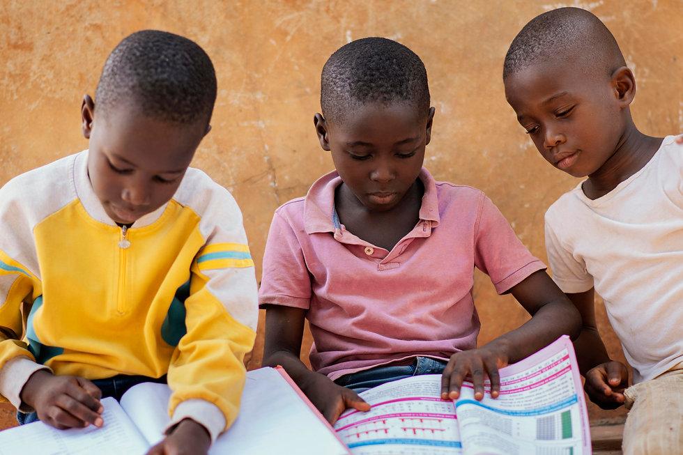 close-up-african-kids-reading-together.j