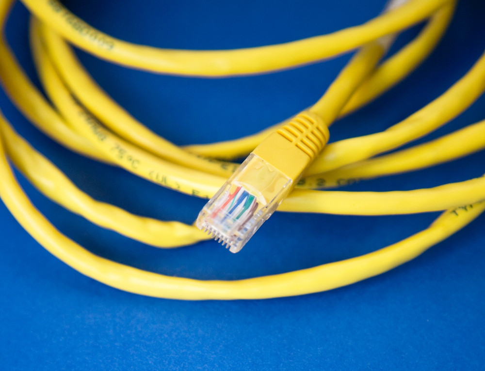 A yellow unplugged ethernet cord