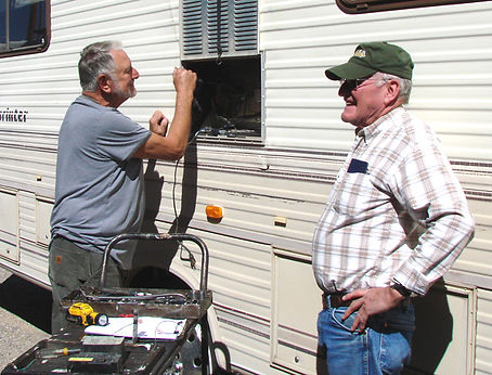 Don Moran repairing a customer's RV
