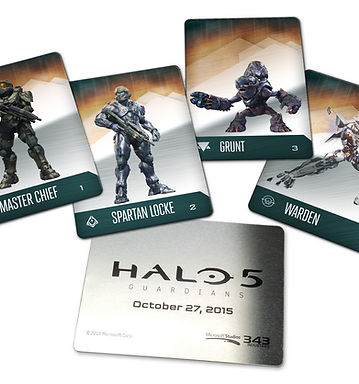 Front and back of metallic trading cards featuring the four main characters in Halo 5: Guardians – Master Chief, Spartan Locke, Grunt, and Warden.