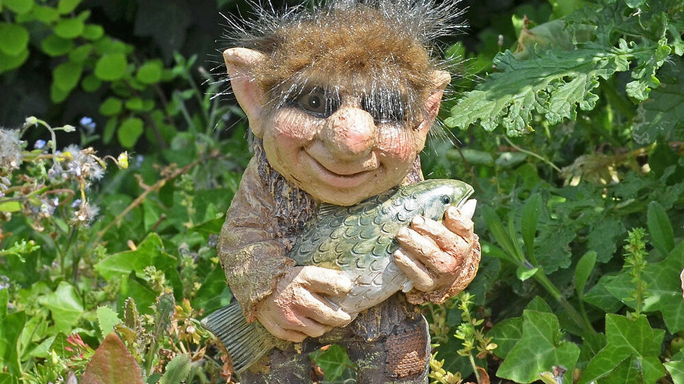 Troll Holding A Fish