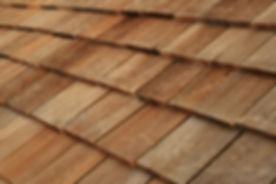 Diagonal detail of brown wood roof shing
