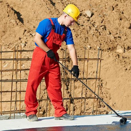 builder worker in uniform covering roof