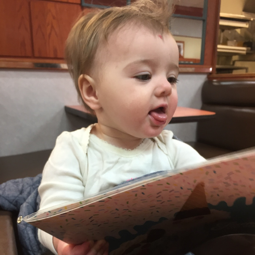 Imogene at Friendly's, checking out the menu.