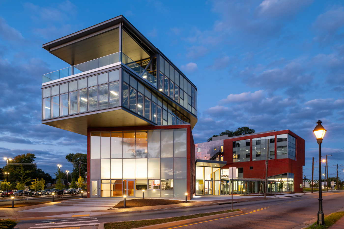 The Culinary School activates 1st & 2nd floors. Workforce apartments sit above the east arm. Community offices & destination restaurant reach off the west arm toward downtown Richmond.