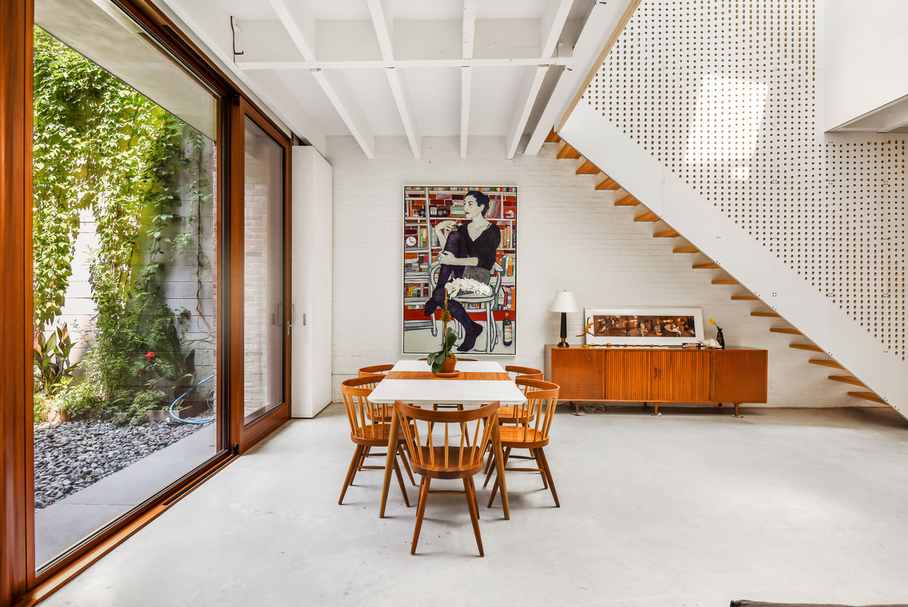 The boundaries between interior and exterior are porous in this hybrid loft/courtyard/rowhouse; the living spaces focus inward to the Light Volumes, which in turn open out to garden and sky.
