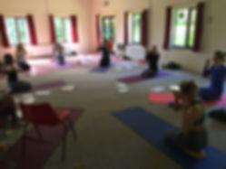 Skip Oliver teaching children's yoga breathing