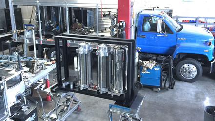 COMPACT WASTEWATER CONVERSION, FUEL PRODUCTION, & POWER GENERATION SYSTEM FOR FLAT-BED TRUCK