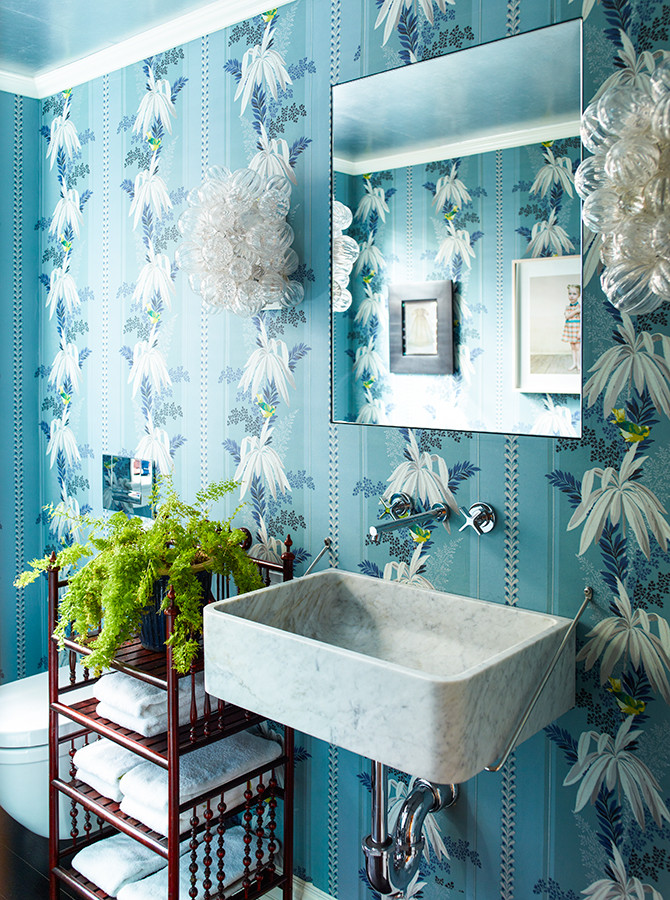 Wallpapered powder rooms always make a statement! I love how the colour of the fern matches the birds in the wallpaper design. Image: Katie Ridder www.katieridder.com
