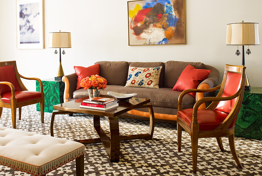 I love the warm colour scheme of this room and how the abstract painting stays in the focal point. Image: Katie Ridder www.katieridder.com