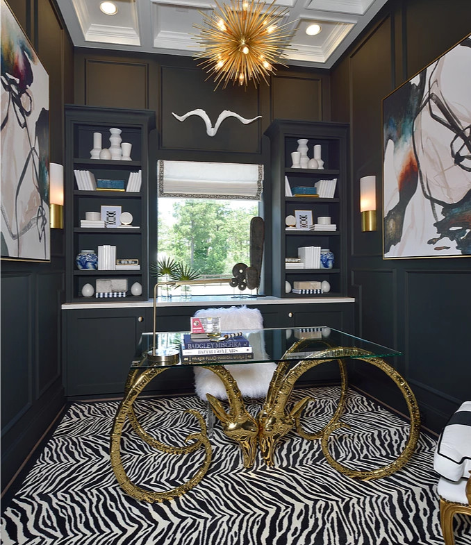 The zebra rug and the golden antelope table legs create a beautiful safari style int his room. Image: veronicasolomon.com