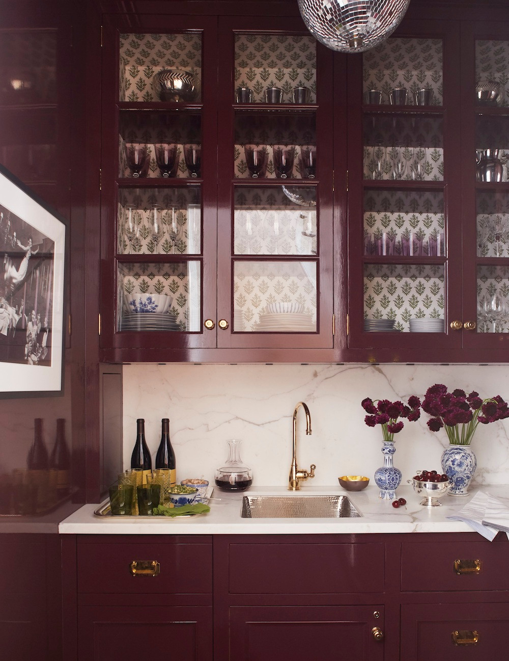 Such a rich colour on the cabinets! The marble texture anchors the small pattern in the cabinets nicely. Image: Ashley Whittaker Design