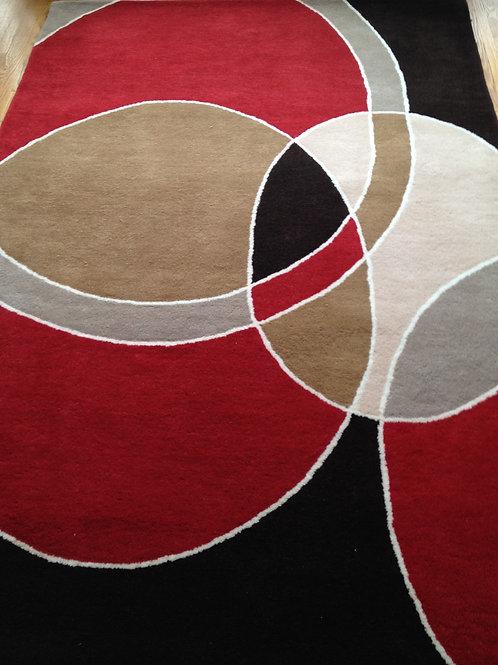 Circles graphic modern geometric red/brown hand-tufted New-Zealand wool custom area rug, Judit Gueth Design, Toronto