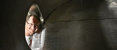 Owner Ted Rosenzweig peaking into an open brew tank
