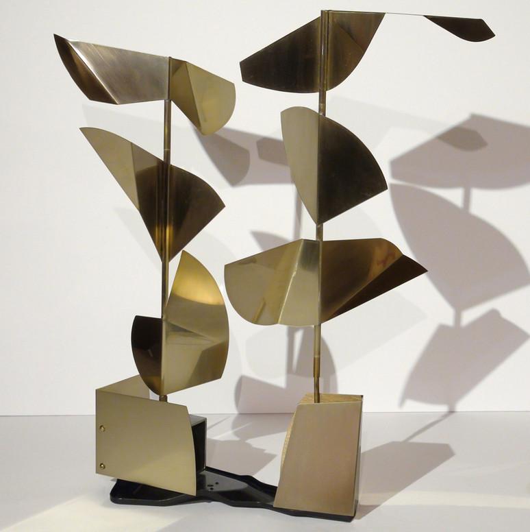 Twin Columns-Revolving Brass Forms