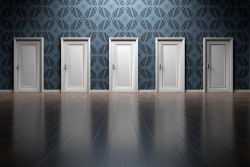 white doorways on blue wall