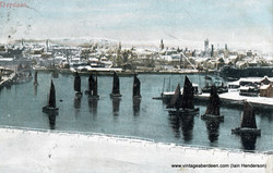 Sailing fleet leaving harbour (1904)