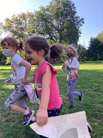 1st grade running holding hands.jpg