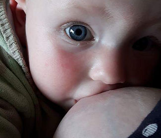 Close up of baby breastfeeding