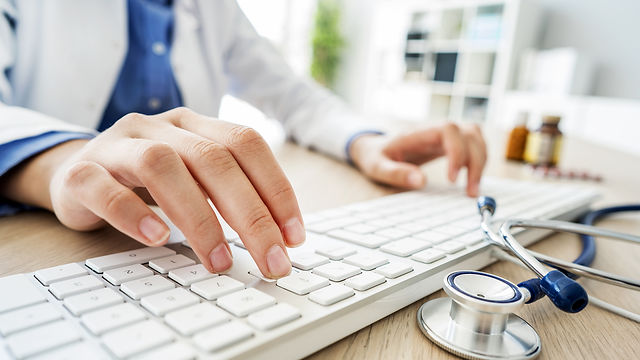 Female-doctor-typing-on-comput.jpg