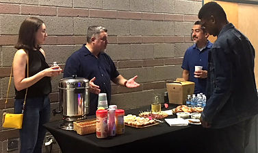 Horizon Church Tucson Life Group - Action shot of adults talking and getting coffee.