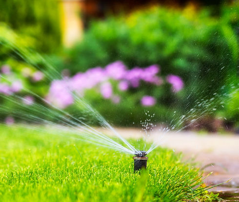 automatic%20sprinkler%20system%20watering%20the%20lawn_edited.jpg