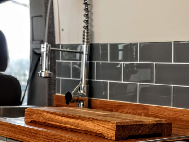 Stainless sink & tap, fired earth tiles and solid oak counter. MWB Crafter Kitchen