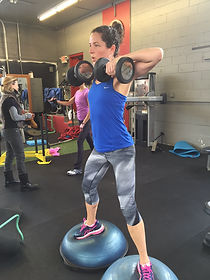 new moms strength training while balancing on bosu