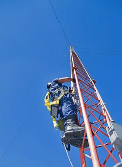 Climber On Antenna Tower